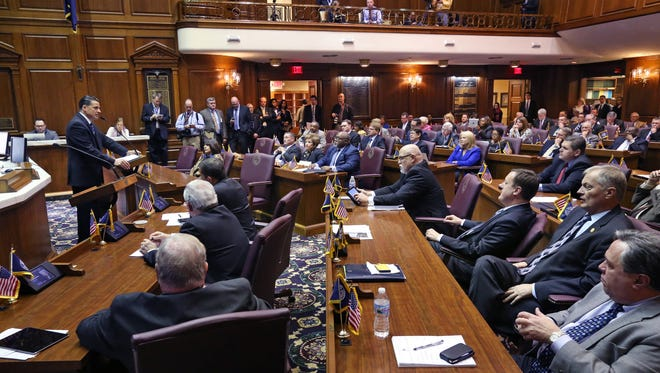 House Minority Leader Scott Pelath (standing at left), D-Michigan City, addresses the Indiana House of Representatives on opening day of the 2015 General Assembly at the Statehouse in Indianapolis on Jan. 6, 2015.