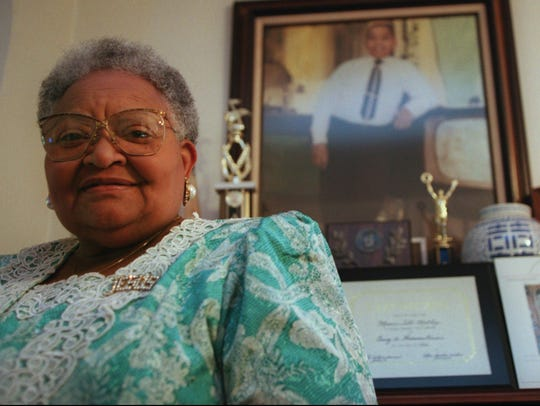 In this 1995 file photo, Mamie Till Mobley stands before a portrait of her slain son, Emmett Till, in her Chicago home.