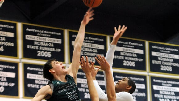 Christ School's John Fulkerson blocks a shot Friday in Swannanoa.