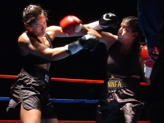 Ninfa Herrera, pictured on the right here in 2003, was the first woman to box professionally from Corpus Christi. She fought for the Corpus Christi Police Officers Association Boxing Club.