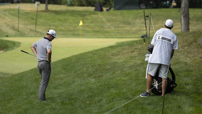 Zach Johnson considers his predicament after hitting into the rough to the right of the 15th fairway during the final round of the Memorial Tournament on Sunday.