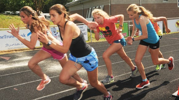Roberson senior Lauren Moody (front row, left) has committed to run college track for the University of North Carolina.