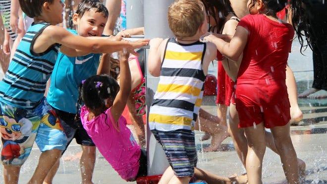 Kids enjoy the splash pad in 2019.