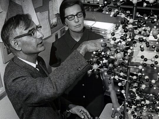 Nobel winning UW biochemist Har Gobind Khorana and his wife, Esther, examine a mode of the DNA molecule of life, in the scientist's Madison laboratory.