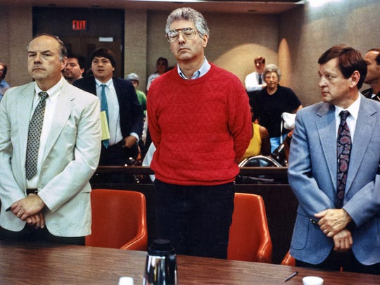 Dr. John F. Boyle, pictured here during his trial, got life in prison for the aggravated murder of his wife Noreen in 1990. With him here are attorneys Robert Whitney, left, and Charles Robinson.