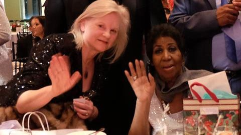 Susan Whitall with Aretha Franklin at her holiday soiree in December 2016.