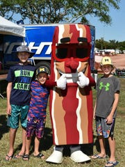 Burke, Tate and Gage Seeger pose with the Bacon mascot