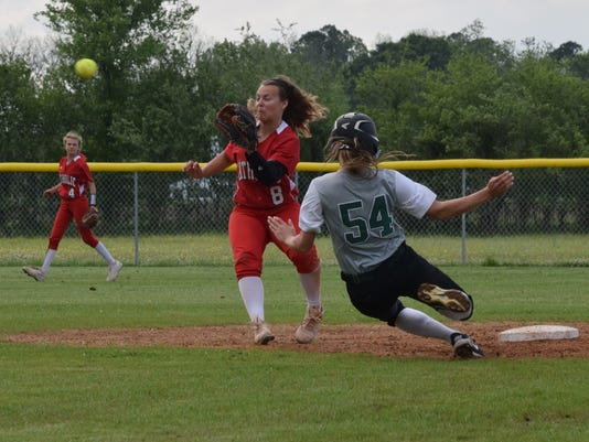 Rapides' Cheyanne Guillory (54, right) beats Catholic-New Iberia's Hannah Smith's (8, left) tag as she steals second.