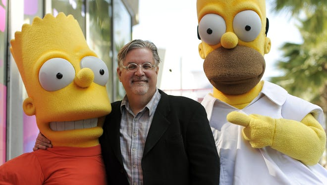 "FILE - In this Feb. 14, 2012 file photo, Matt Groening, creator of the animated series ""The Simpsons,"" poses with his character creations Bart Simpson, left, and Homer Simpson after he received a star on the Hollywood Walk of Fame in Los Angeles. One of the best-kept secrets in television history has been revealed, with Groening pointing to Springfield, Ore. as the inspiration for the animated hometown of Homer and family."