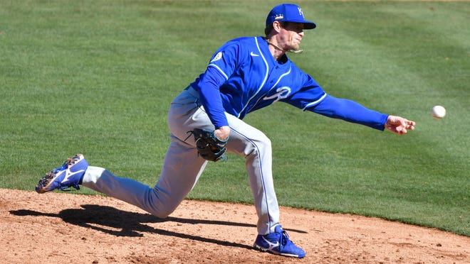 Tim Hill pitches for the Kansas City Royals in a spring training game in February. Hill, who has survived cancer, was traded to the San Diego Padres Thursday for pitcher Ronald Bolanos and outfielder Franchy Cordero.