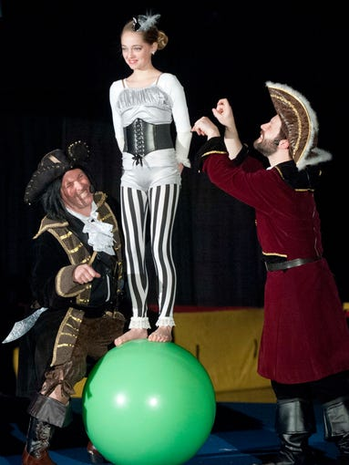 Captain Black Bart Bartemaeus, played by Dean Sernellis) the evil pirate captain, left,  and Aar Roberts, played by Aaron Wallace Johnson, right, tease acrobat Elka Miller  in the Turners Louisville 2014 circus, Shipwrecked!. March 16, 2014
