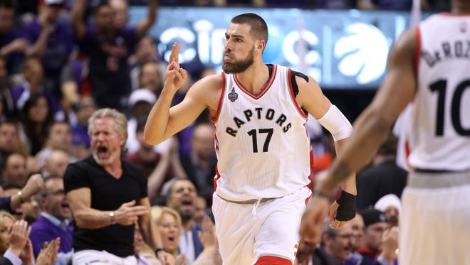 Toronto Raptors center Jonas Valanciunas (17) celebrates after making a basket against the Indiana Pacers in game two of the first round of the 2016 NBA Playoffs at Air Canada Centre.