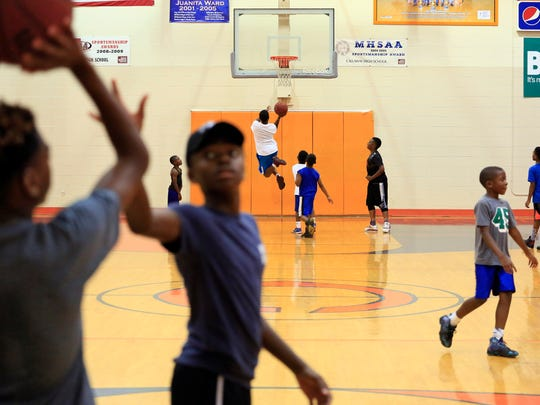 Children play basketball during the J.T. and Friends Youth Sports Camp at Callaway High School Tuesday.