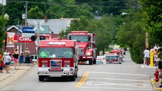 Byesville fire trucks lead the way up Main Street in this file photo from the Fireman's Festival parade.
