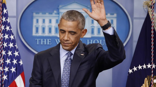 President Barack Obama waves at the conclusion of his final presidential news conference, Wednesday in the White House in Washington.