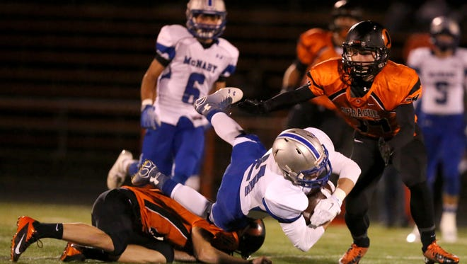 McNary's Brady Sparks runs the ball duirng their game on Friday Oct. 31, 2014, in Salem, Ore.
