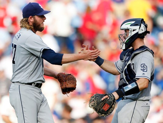 San Diego Padres relief pitcher Brandon Maurer, left, is congratulated by catcher Austin Hedges after they defeated the Philadelphia Phillies in a baseball game, Saturday, July 8, 2017, in Philadelphia. (AP Photo/Laurence Kesterson)