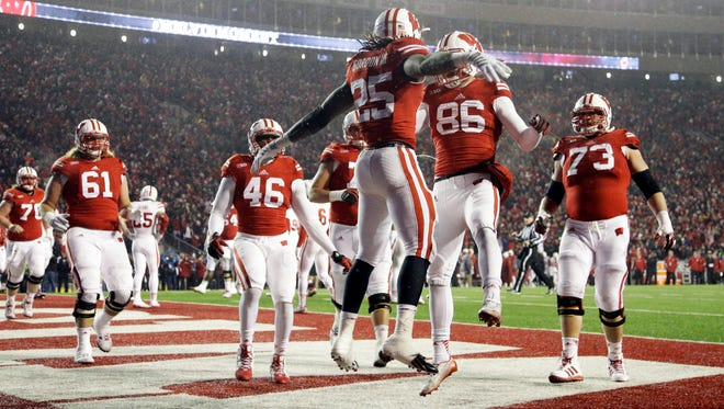Wisconsin's Melvin Gordon celebrates a 1-yard touchdown run with his blockers in the third quarter Saturday.
