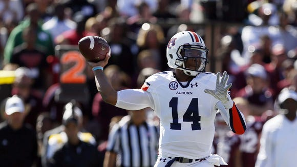 Auburn quarterback Nick Marshall was named the Southeastern Conference?s offensive player of the week for his performance against Texas A&M.  SOOBUM IM/USA TODAY Oct 19, 2013; College Station, TX, USA; Auburn Tigers quarterback Nick Marshall (14) throws the ball against the Texas A&M Aggies during the first half at Kyle Field. Mandatory Credit: Soobum Im-USA TODAY Sports