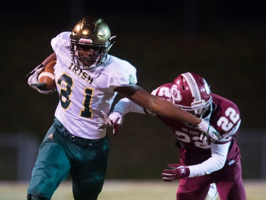 Knoxville Catholic's Joshua Brown (31) runs with the