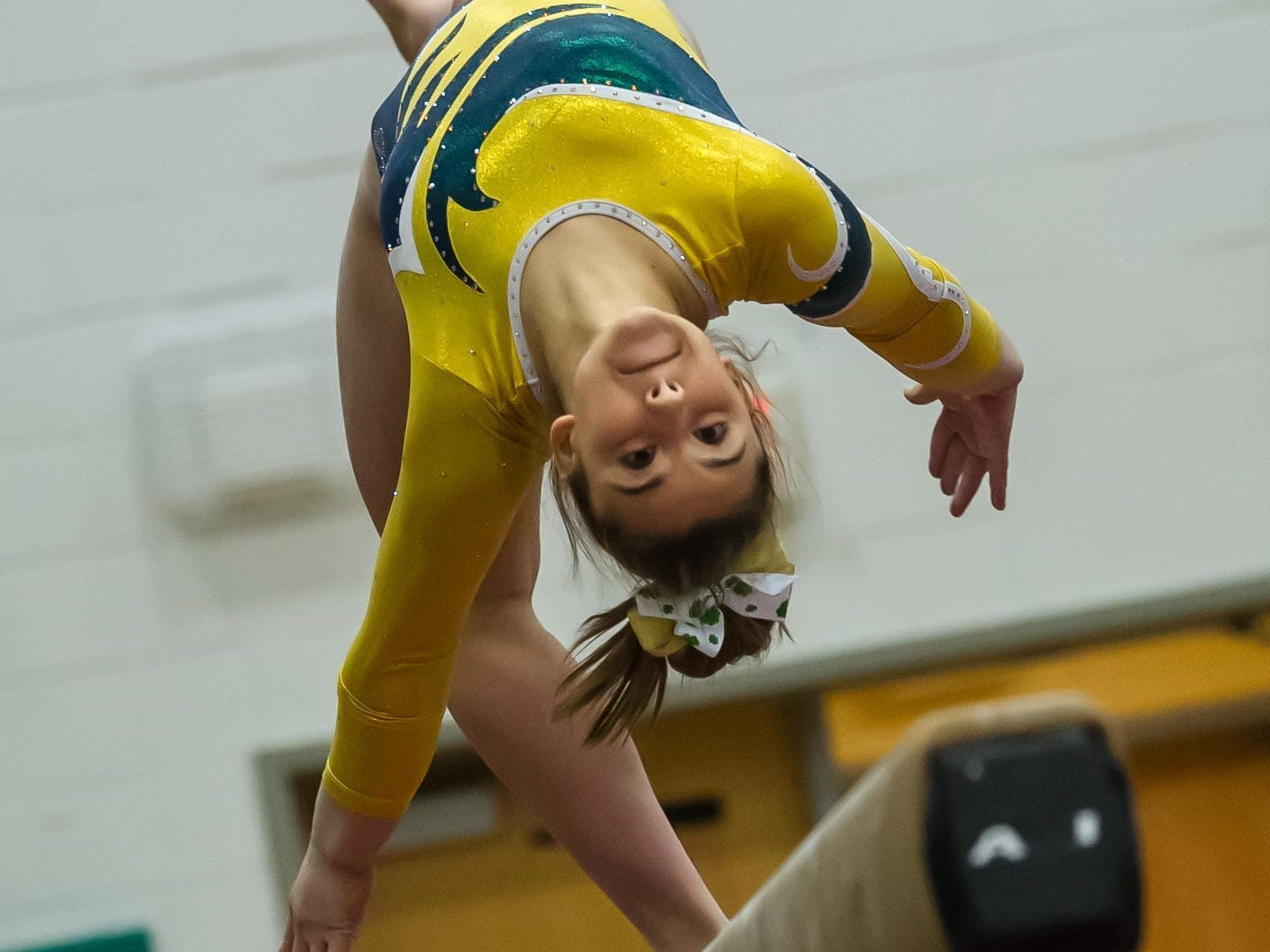 Red Bank Catholic's Ally Cucich competes on the beam in the NJSIAA Gymnastics state individual championship at Montgomery High School on Saturday Nov. 14, 2015. Photo by Jeff Granit