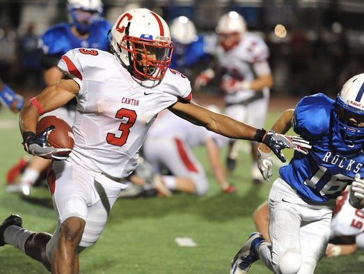 Canton running back Colin Troup (3) breaks to the outside