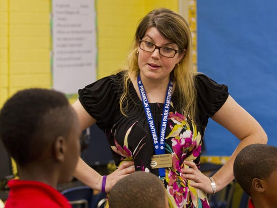 First-year teacher Amanda Preston, begins her third-grade class Monday morning at Franklin Park Elementary School in Fort Myers.