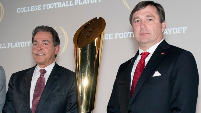 Nick Saban, of Alabama, left, and Kirby Smart, right, of Georgia, pose together before the College Football Awards show.