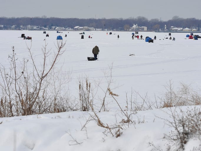 Lake st clair ice fishing draws hardy lot for Ice fishing lake st clair