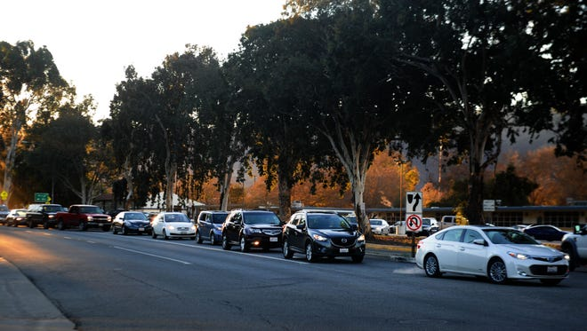The line of cars waiting to make a left turn into the Nordhoff High School parking lot gets long in the morning. Traffic at the school prompted the city of Ojai to appeal the Ventura County Planning Commission's approval of a conditional-use permit for a nearby quarry, whose trucks use Highway 33. The Board of Supervisors reached a compromise with the quarry owner.