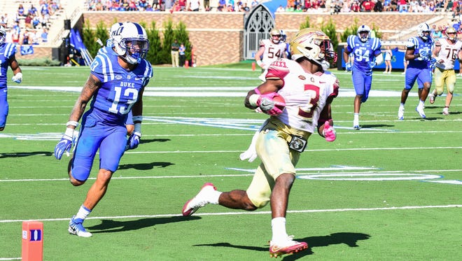 Florida State freshman running back Cam Akers (3) scores his first career touchdown during the fourth quarter against Duke on Saturday at Wallace Wade Stadium.