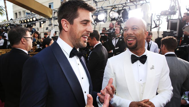 Aaron Rodgers, left, and Common arrive at the Oscars on Sunday, Feb. 28, 2016, at the Dolby Theatre in Los Angeles. (Photo by Matt Sayles/Invision/AP)