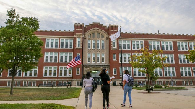 Students enter Central High School in Providence on Monday for the start of the school year.
