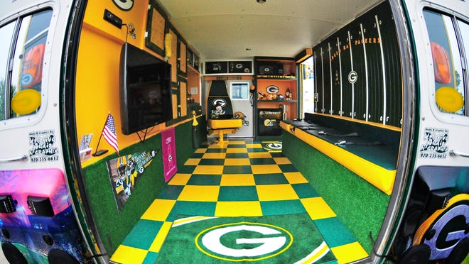 The Kerkhoffs gutted the inside and installed some game-day essentials: a microwave, a small refrigerator, a 12-speaker sound system and a 32-inch LED TV on a swing-out arm for easier viewing from outside.