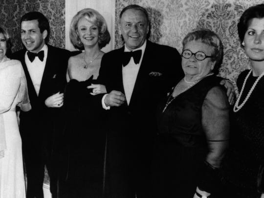 Actor Frank Sinatra, center, poses with his family during an awards presentation, from left, daughter Nancy Sinatra, son Frank Sinatra Jr., Barbara Sinatra, mother Dolly Sinatra, and daughter Tina Sinatra in Los Angeles on November 19, 1976.