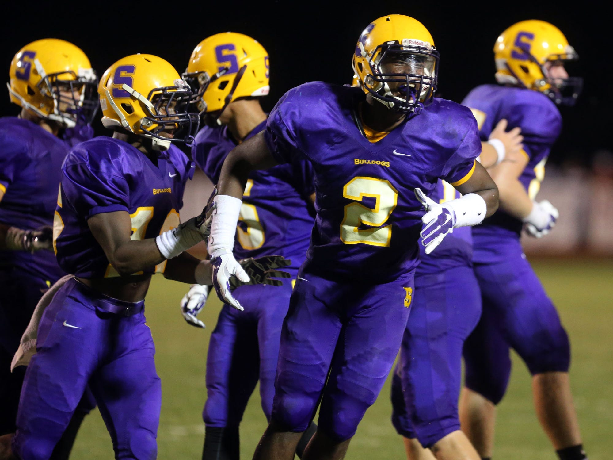 Smyrna's Ikenna Okeke(#2) celebrates after recovering a fumble by La Vergne in the second quarter at Smyrna Thursday, August 21, 2014.