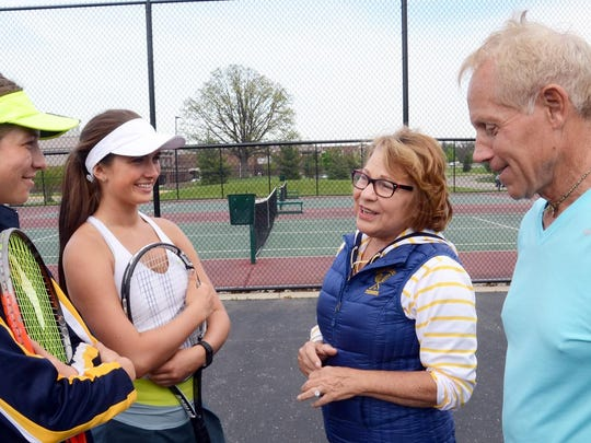 Hartland tennis coach Judy Jagdfeld, second from right
