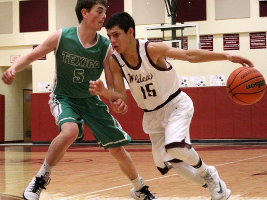 Tularosa's AJ Betancur, right, tries to dribble past Texico's Ben Crist on Saturday evening.