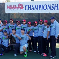The Novi boys tennis team celebrates its first MHSAA Division 1 state championship Saturday in Midland.