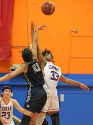 Central High School's Tay Dosson (33) goes up for a