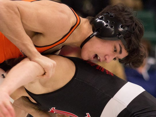 Ryan Salmon, left, won by decision at 145 pounds Sunday,