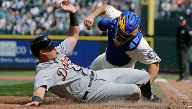 Detroit Tigers' James McCann is tagged out at home by Seattle Mariners catcher David Freitas during the sixth inning Sunday, May 20, 2018, in Seattle.