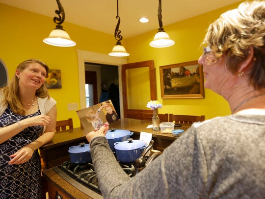 Kathy Pehlke, a trained doula, looks at photos with