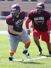 Arcadia defensive end Chuck Finocchario, left, turns off the line and pursues the ball.