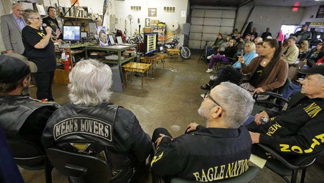 "Fox Crossing resident Kay Reetz discusses the police shooting death of Michael L. Funk during a broadcast of the national talk show ""For the People"" at Eagle Nation Cycles in Neenah."