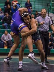 Francisco Alvarez attempts a take down against Kirtland Central's Brandon Silage on Tuesday at Scorpion Gym in Farmington.