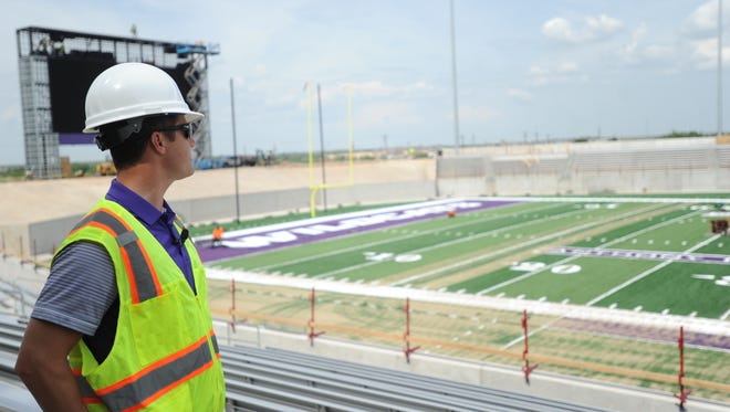 ACU director of athletics Lee De Leon looks across the field from the home side concourse during a media tour of the school's new football stadium. Wildcat Field is scheduled to open Sept. 16, when ACU plays Houston Baptist in a Southland Conference game after opening the season with two road games.