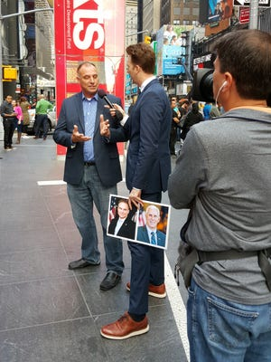 """""""Pence Must Go"""" creator Kevin Warren, left, is interviewed by """"The Daily Show"""" correspondent Jordan Klepper, right, in Times Square on Oct. 3."""