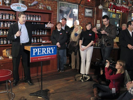 Republican presidential candidate, Texas Gov. Rick Perry speaks during a campaign stop at the Smokey Row Coffee Shop in Pella, on Wednesday, December 28, 2011.