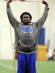 Bills wide reciever Sammy Watkins, stretches with an elastic band during a voluntary offseason conditioning session in April.